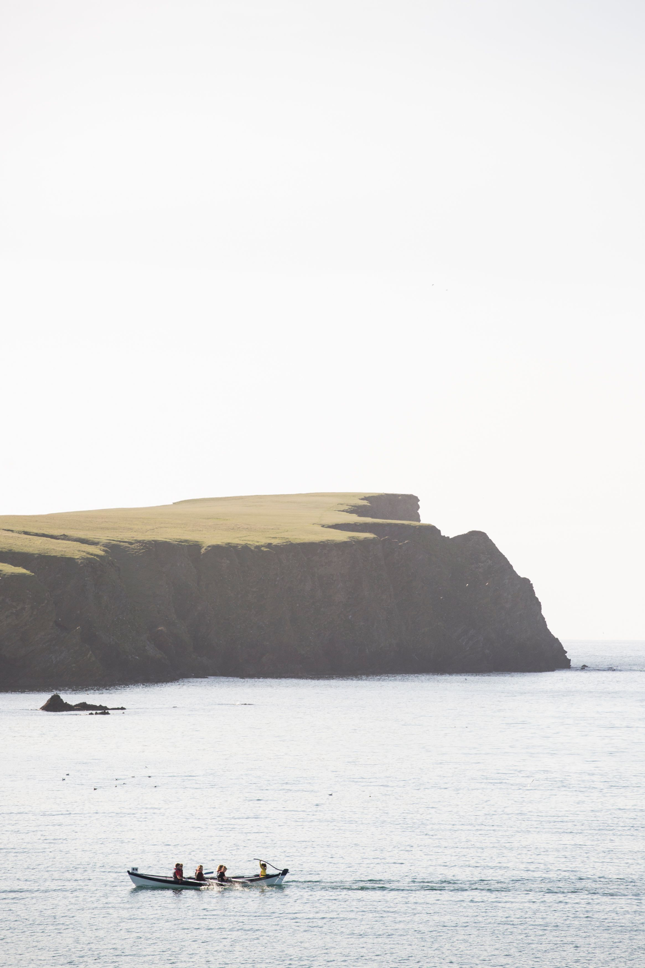 Yoal rowing in front of St Ninian's Isle | River Thompson