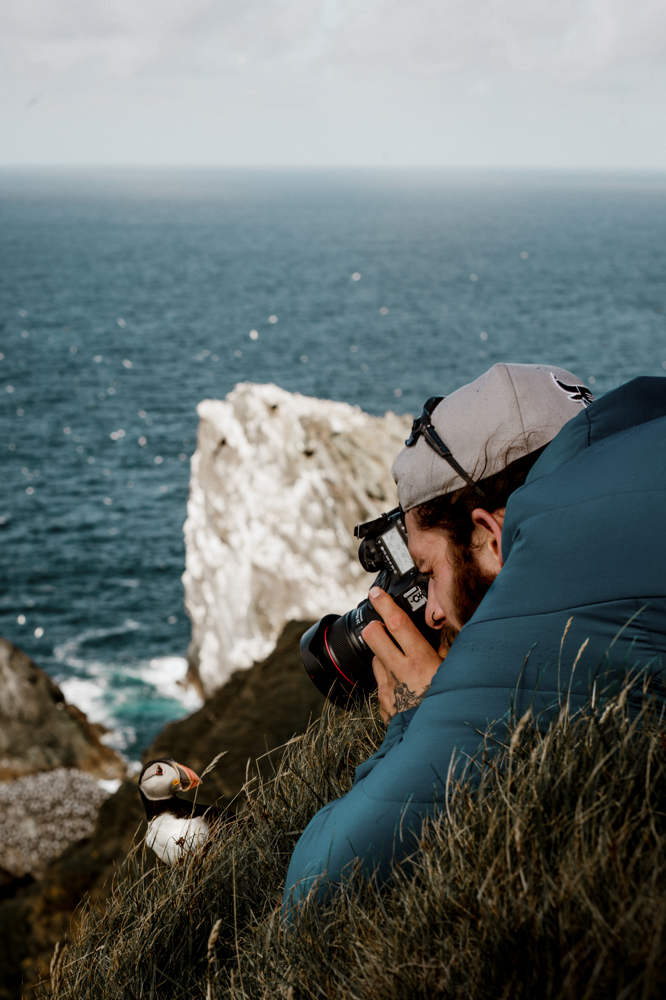 Ritchie Williams photographing a puffin at Hermaness | Susan Molloy