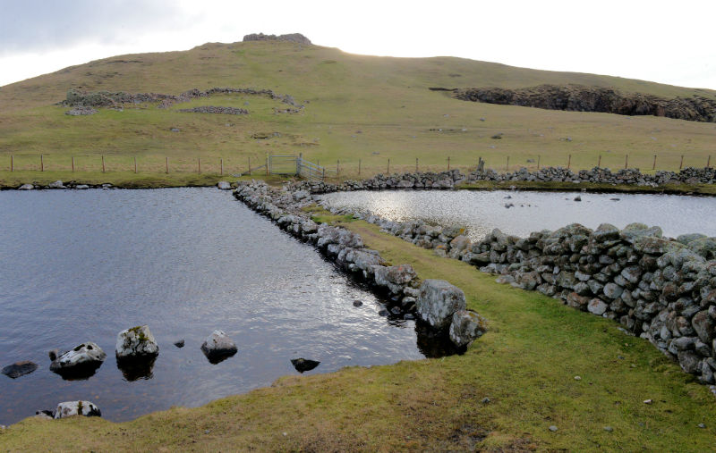 A causeway leads across the loch to Culswick Broch (Courtesy Alastair Hamilton)