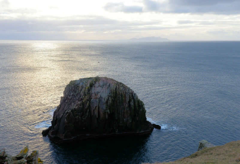 One of the stacks near Culswick broch, with Foula in the distance (Courtesy Alastair Hamilton)