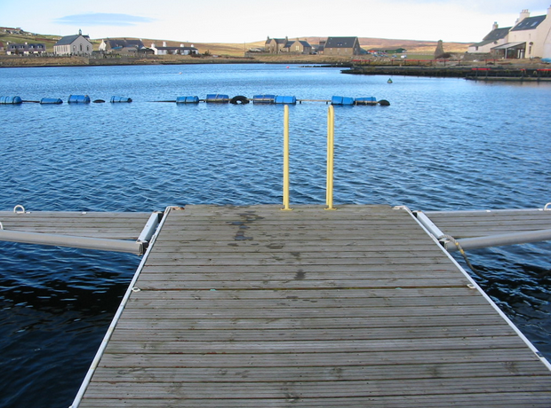 Walls, set around a sheltered bay, is seen here from its marina (Courtesy Promote Shetland)